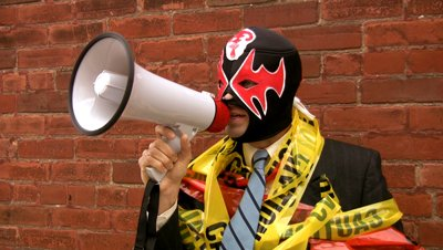 stock-footage-scary-boss-a-businessman-with-megaphone-mexican-wrestling-mask-and-caution-and-danger-tape